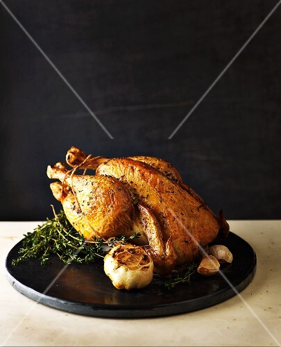 A roast chicken with thyme and garlic