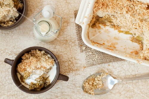 Rhubarb and vanilla crumble and a small bottle of cream