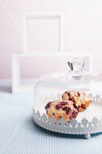 Berry muffins under a glass cloche
