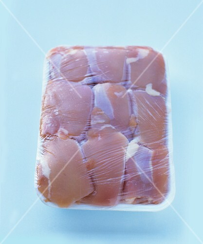 Chicken thighs packaged in styropore
