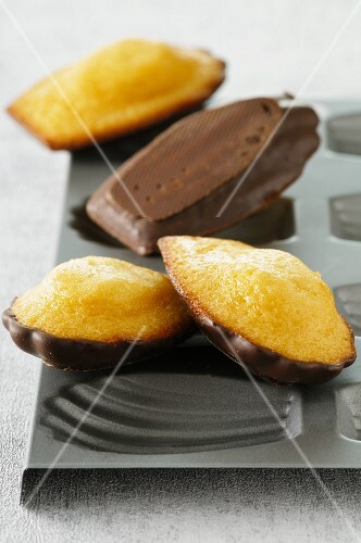 Madeleines with chocolate glaze on top of the baking tin