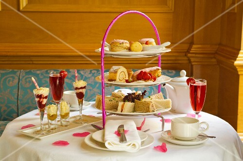 Cake, desserts, sandwiches and drinks for high tea