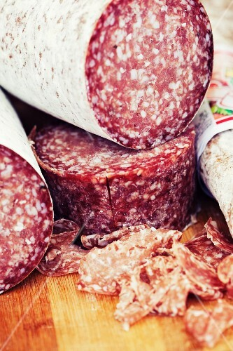Whole salami and sliced salami