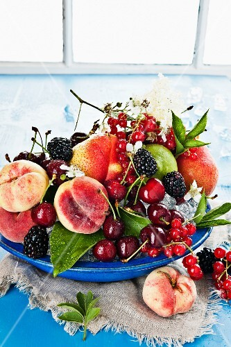 An arrangement of fruit and berries