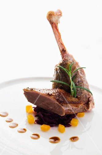 Goose leg with red cabbage and pumpkin
