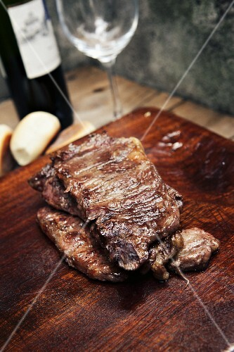 Grilled meat, bread and red wine