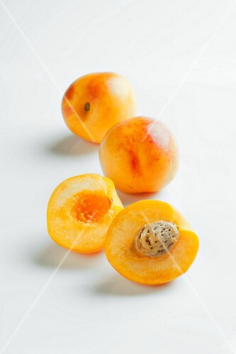 Three nectacots (a cross between an apricot and a nectarine)