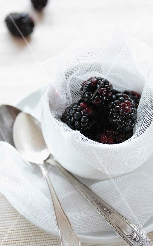 Blackberries in a dish lined with fabric