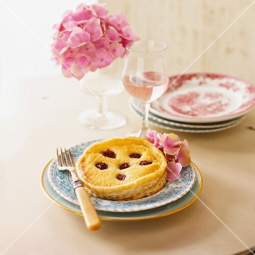 A cherry tartlet with pink hydrangeas