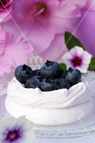 A meringue nest filled with blueberries