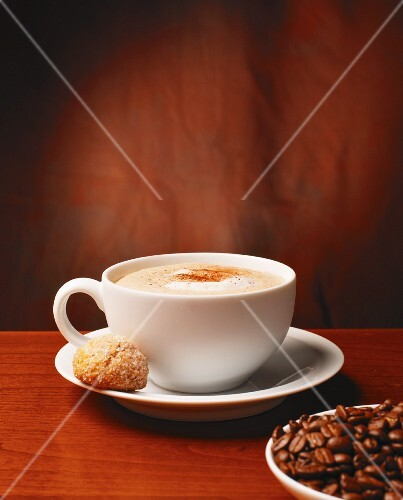 Cappuccino, amaretti and coffee beans