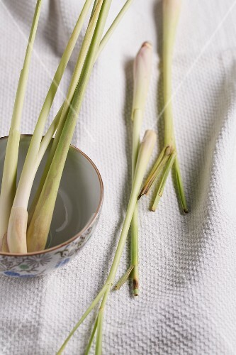 Lemongrass in a bowl and on a tea towel