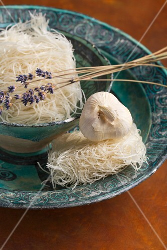 Rice noodles with lavender and garlic in a ceramic dish