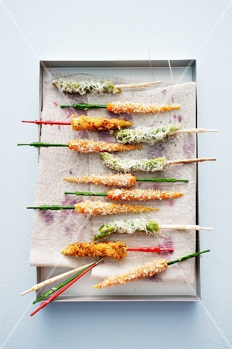 Coconut carrots, asparagus tips with Parmesan and crispy corn cobs with Chile