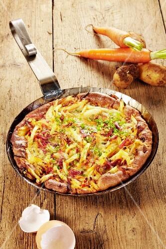 Pillekuchen (potato pancake) with carrots