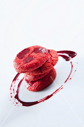 A stack of cookies with beetroot sauce