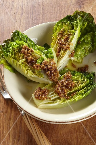 Cos lettuces halved and fried served with a dressing made from coarse mustard