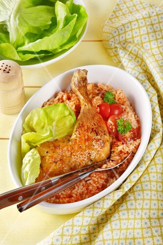 Roasted chicken leg on a bed of tomato rice