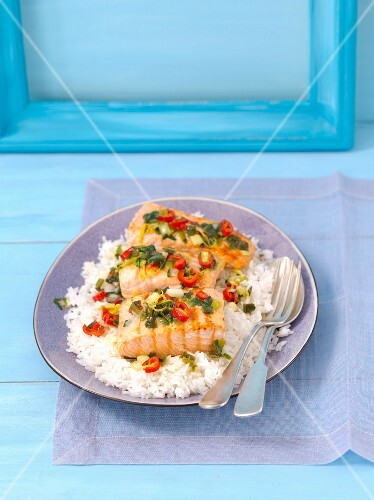 Salmon fillet with rice, chilli peppers, spring onions and coriander