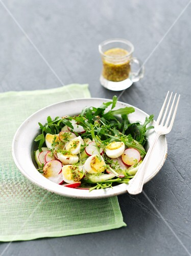 Rocket salad with cucumber, radishes, quail's eggs and a mustard vinaigrette