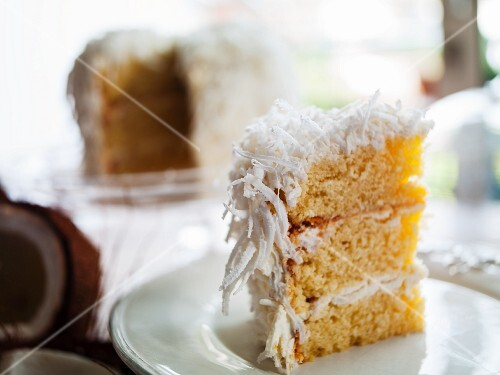 A slice of coconut cake on a plate