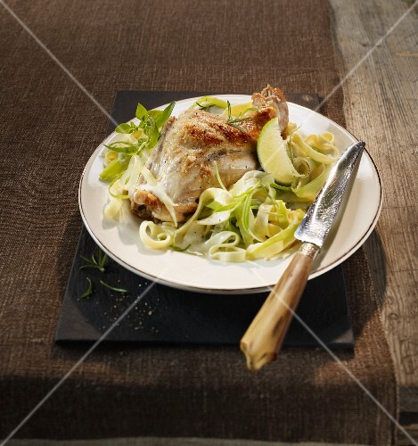 Rabbit leg with a lime sauce and leek tagliatelle