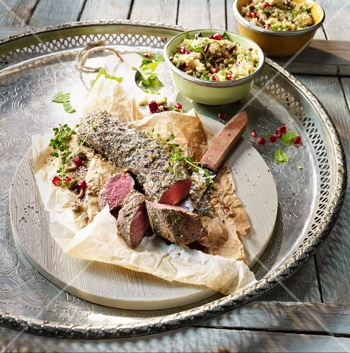 Grilled saddle of venison with a colourful couscous salad
