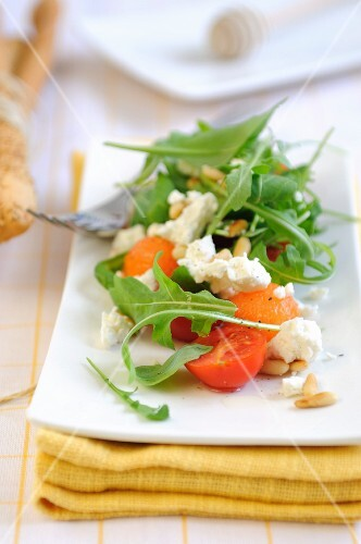 Cherry tomato salad with melon, feta cheese and rocket