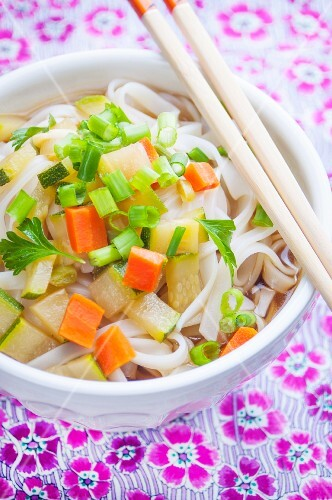 Vegetable and rice noodle soup with chopsticks (Asia)