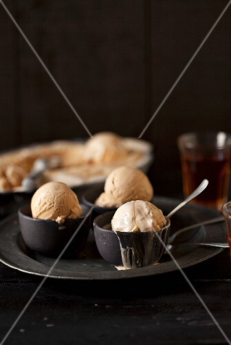 Caramel ice cream in small dishes