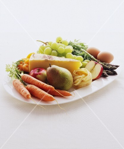 Vegetables, fruit, cheese, pasta and eggs on a serving platter