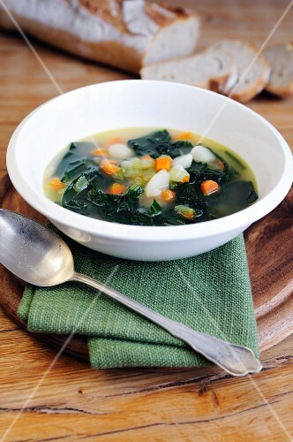 Minestrone soup with black kale, onions, potatoes, carrots and celery