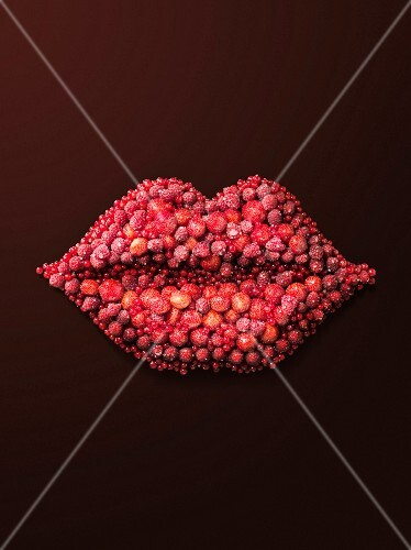 A pair of lips made from red berries