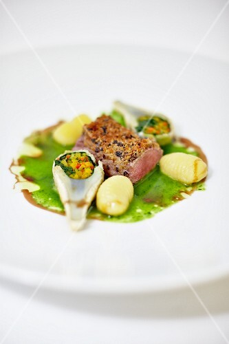 Venison fillet with artichokes and gnocchi