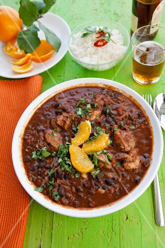 Feijoada (bean stew, Brazil) with pork, oranges and rice