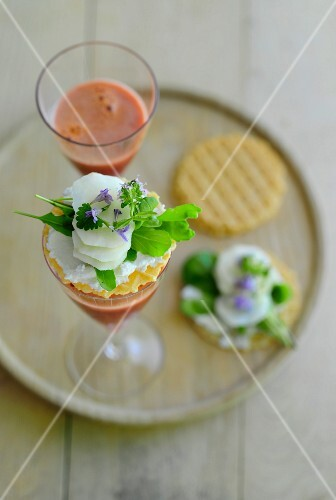 Canapes with vegetables and herbs and glasses of carrot juice