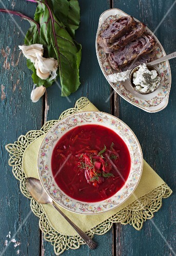 Vegitarian borscht with bread and a cheese spread