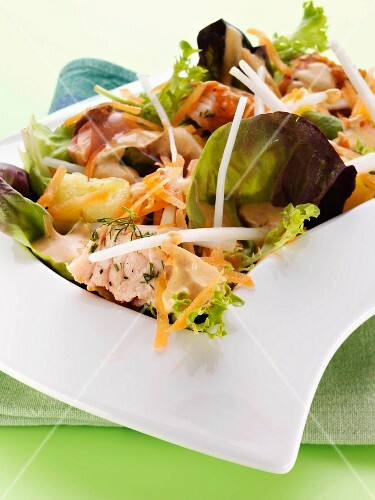 A mixed leaf salad with grilled salmon