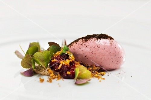 Lingonberry ice cream with sorrel and fried bread crumbs