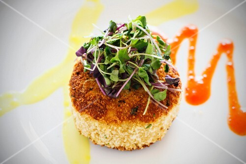 Fried grits cake with fresh cress