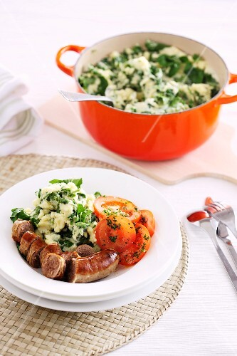 Sausage with cress mashed potatoes and tomatoes