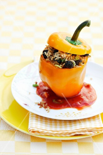 A stuffed pepper with tomato sauce