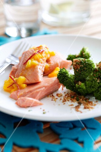 Salmon fillet with peach sauce and broccoli