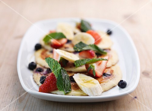 Pancakes with fruit salad and mint