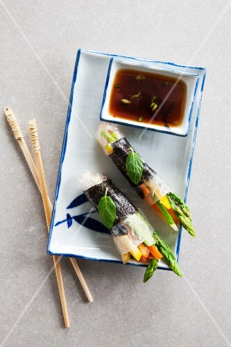Rice paper rolls filled with vegetables and served with soy sauce