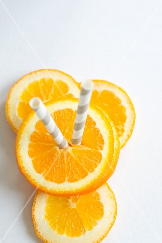 Orange slices with straws (seen from above)