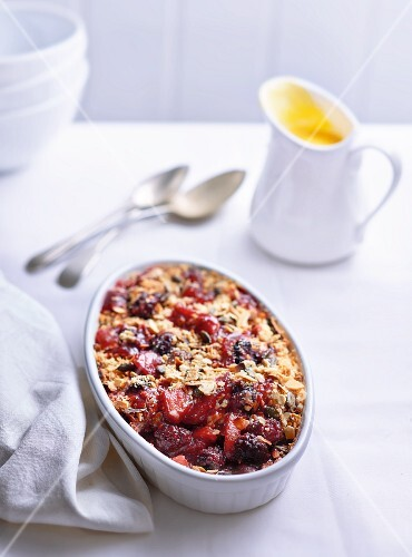 Berry crumble and vanilla sauce