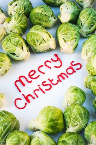 The words 'Merry Christmas' surrounded by Brussels sprouts