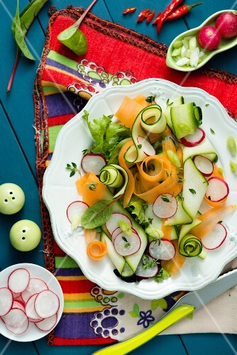 A colourful vegetable salad with radishes, carrots and cucumber