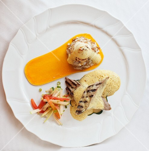 Grilled chicken fillets with foamy sauce and butternut squash